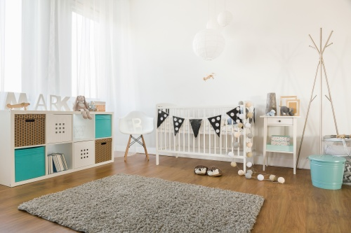 Picture of cosy and light baby room interior